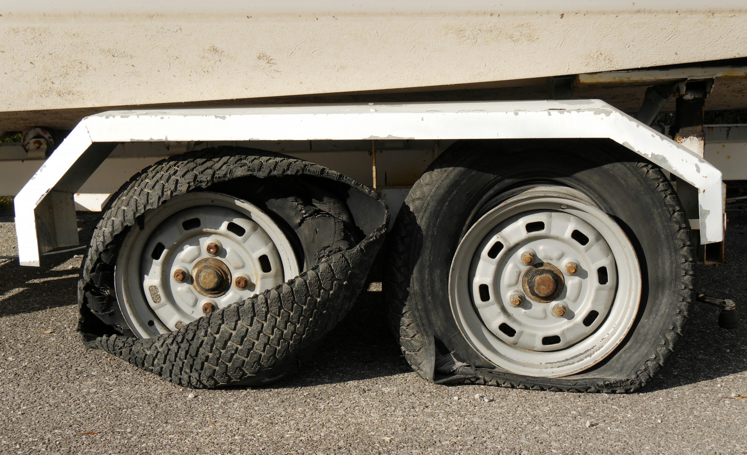 two-blown-out-truck-tires-on-trailer