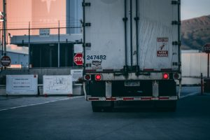 white-semi-truck-trailer-close-up-from-rear