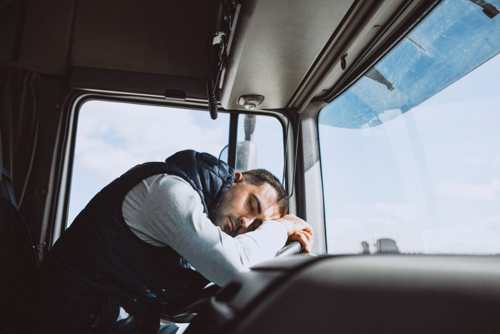 Drowsy Truck Driver Asleep at the Wheel of their semi-truck