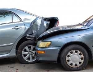Two damaged cars after a rear end accident where the back of the lead vehicle is crushed. Injuries are common in rear end accidents and in no fault states, injured drivers must rely on their PIP insurance first to help pay medical bills.