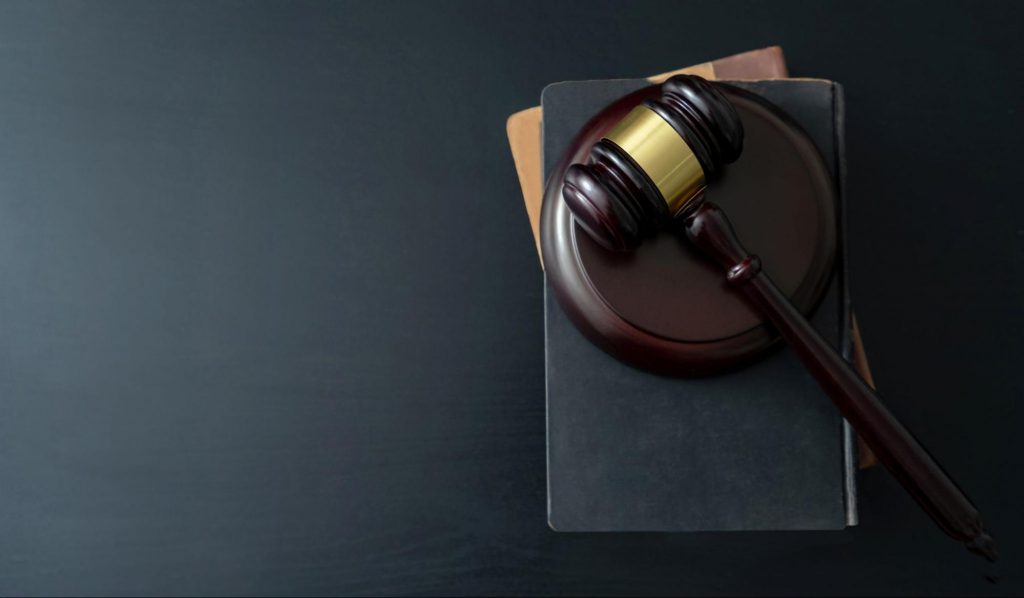 A judge's gavel on top of a stack of law books. Victims of sexual assault have a short period of time in which to file a lawsuit.