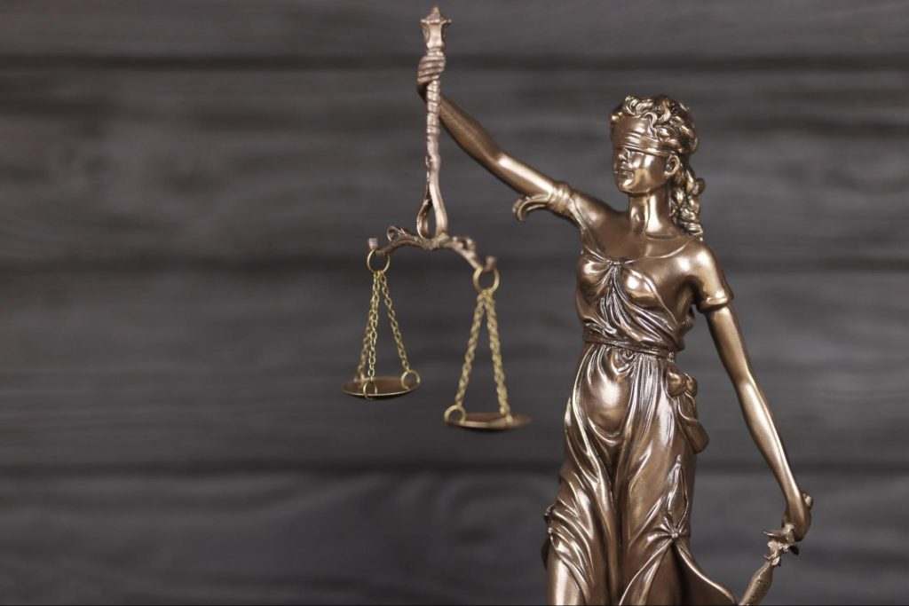 A statue personification of justice as a woman wearing a blindfold and holding scales to indicate the impartiality of the justice system. A sexual assault attorney can help victims of sexual abuse receive the justice that they require.