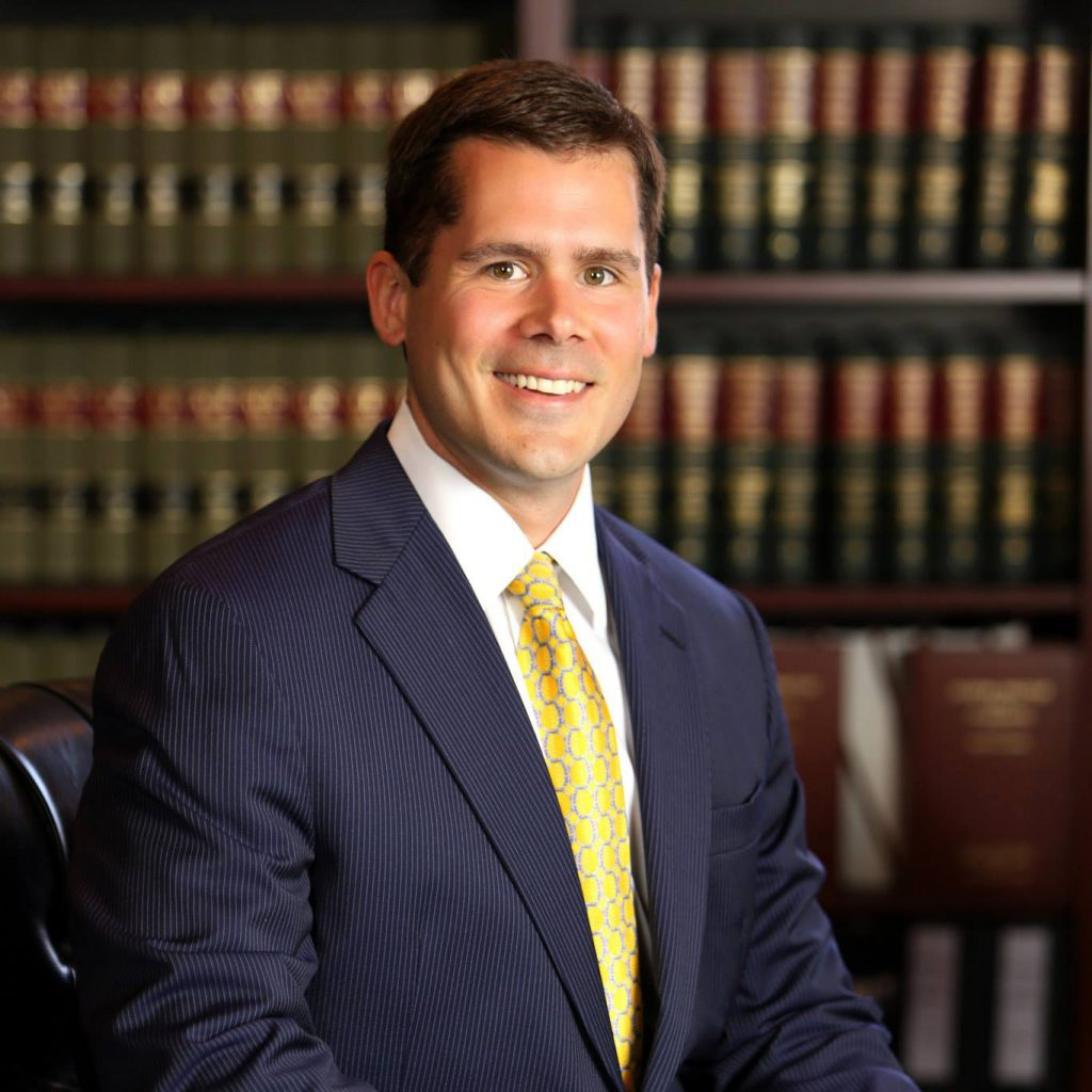 Attorney David Bryant in law library.