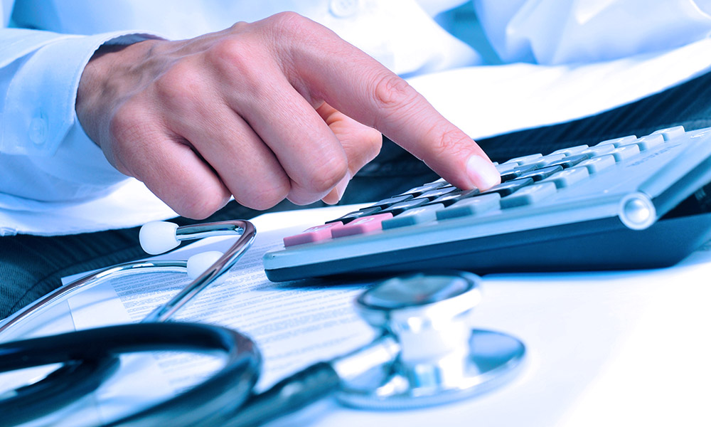 Healthcare professional calculating the cost of treatment for hip injuries.