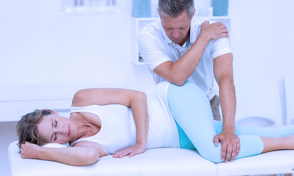 Car accident victim in massage therapy for hip injuries.